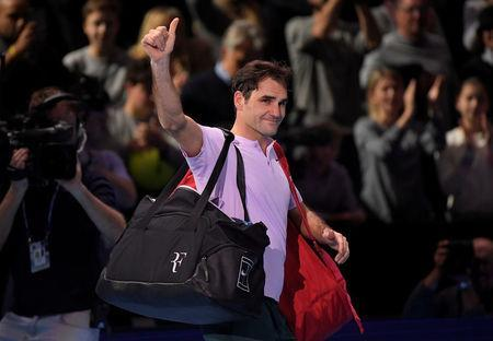 Tennis - ATP World Tour Finals - The O2 Arena, London, Britain - November 18, 2017 Switzerland's Roger Federer salutes the fans as he leaves the court after losing his semi final match against Belgium's David Goffin REUTERS/Toby Melville