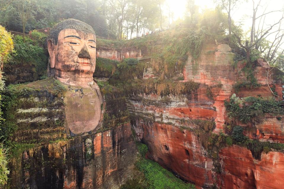 <p>The Buddha statue's toe is as tall as you are!</p>