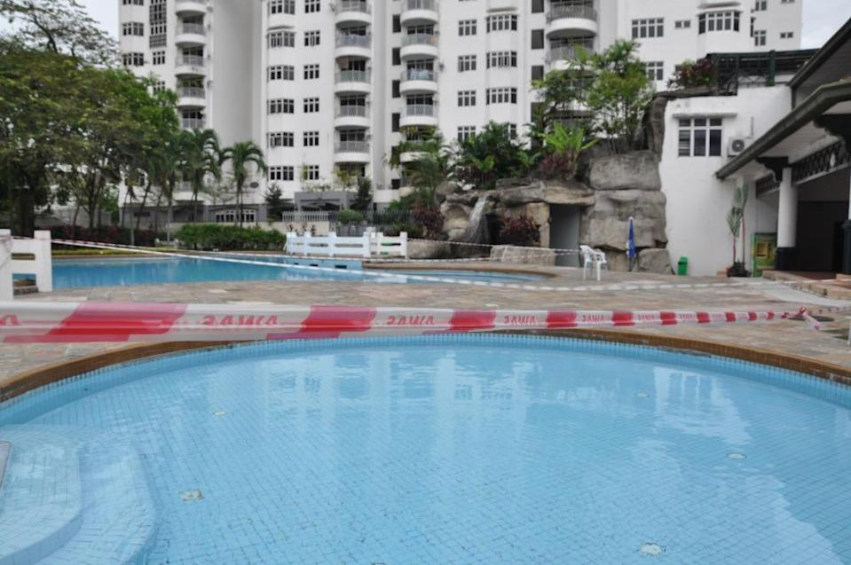 Red tape around a swimming pool. Photo: Coconuts