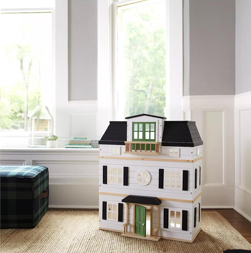"<p>If you're a fan of Chip and Joanna Gaines, then check out this amazing mini Magnolia-inspired farmhouse. As part of the Gaines' home and lifestyle collection, this painted dollhouse, which is composed of natural wood, makes the perfect backdrop for rustic miniature scenes.</p> <p><strong><em>Shop Now:</em></strong> <em>Hearth & Hand with Magnolia Wooden Dollhouse with Furniture, $130, <a href=""https://goto.target.com/c/249354/81938/2092?subId1=MSLTheMiniaturesTrendIsHavingaMomentTryOneofOurFavoriteKitssbamseyDIYGal7988105202009I&u=https%3A%2F%2Fwww.target.com%2Fp%2Fwooden-dollhouse-with-furniture-hearth-hand-8482-with-magnolia%2F-%2FA-52609030"" rel=""nofollow noopener"" target=""_blank"" data-ylk=""slk:target.com"" class=""link rapid-noclick-resp"">target.com</a></em><em>. </em></p>"