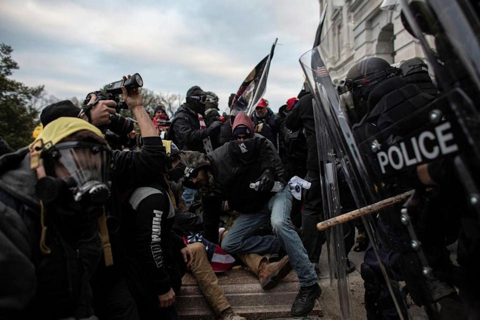 Pro-Trump mob clashes with police as they try to breach the US Capitol on 6 January.