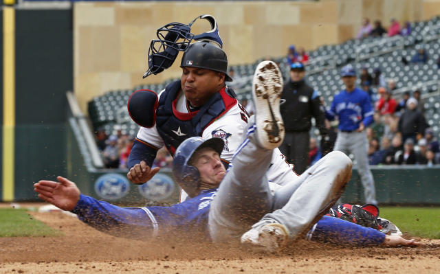Toronto Blue Jays' Billy McKinney, right, beats the tag by Minnesota Twins catcher Willians Astudillo to score on a three-run, bases loaded double by Eric Sogard off Twins pitcher Michael Pineda in the fourth inning of a baseball game Thursday, April 18, 2019, in Minneapolis. (AP Photo/Jim Mone)