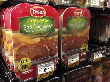 Packages of Tyson food beef meat loaf are reflected in a mirror as they sit on a refrigerator shelf for sale at a grocery store in Encinitas