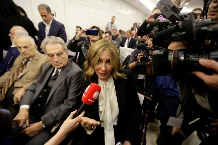 For nearly three hours Ghosn lapped up the attention from the media scrum as his wife Carole sat in the front row (AFP Photo/JOSEPH EID)