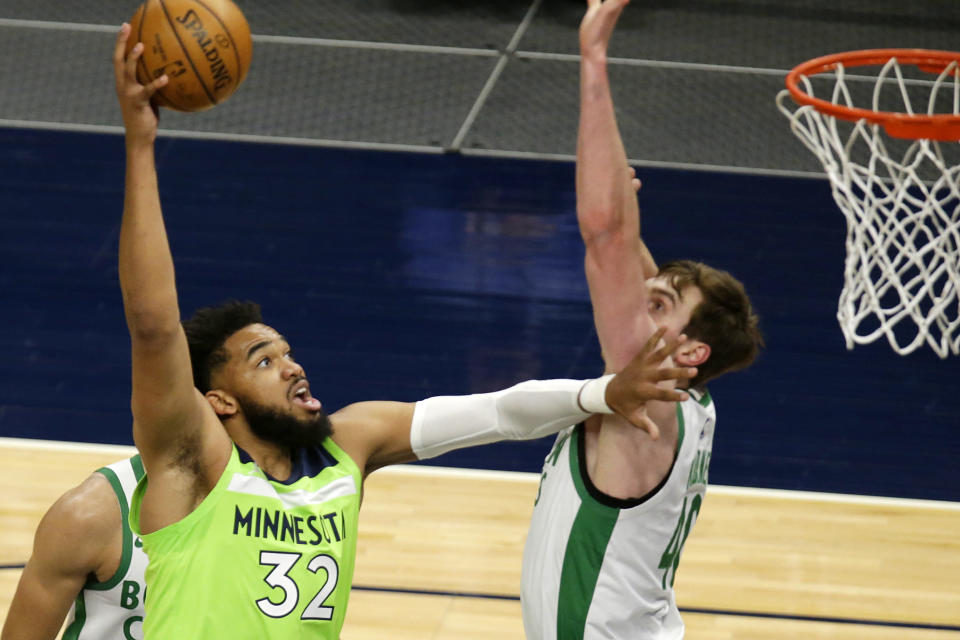 Minnesota Timberwolves center Karl-Anthony Towns (32) shoots over Boston Celtics center Luke Kornet (40) in the first quarter during an NBA basketball game, Saturday, May 15, 2021, in Minneapolis. (AP Photo/Andy Clayton-King)