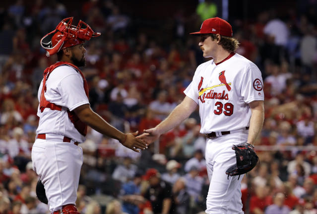 St. Louis Cardinals starting pitcher Miles Mikolas, right, and catcher Francisco Pena celebrate after working the top of sixth inning of a baseball game against the Pittsburgh Pirates Tuesday, Sept. 11, 2018, in St. Louis. (AP Photo/Jeff Roberson)