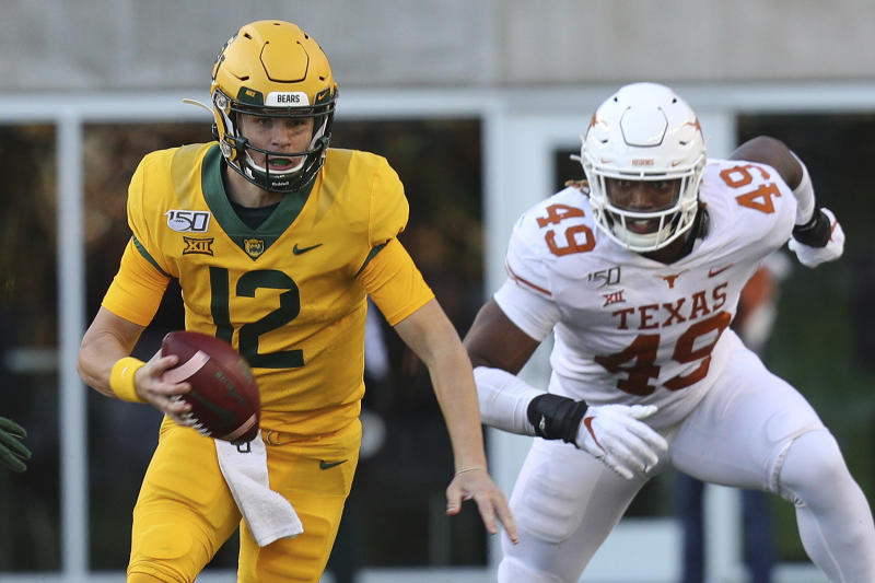 Baylor quarterback Charlie Brewer (12) runs the ball against Texas in the third quarter in an NCAA college football game Saturday, Nov. 23, 2019, in Waco, Texas. (AP Photo/Richard W. Rodriguez)
