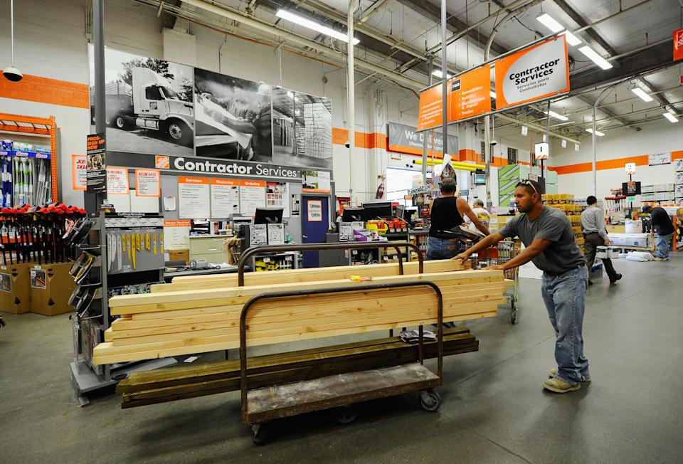 LOS ANGELES - AUGUST 17:  Construction worker Alex Sierra buys lumber for home framing at the Home Depot store on August 17, 2010 in Los Angeles, California. Atlanta-based Home Depot Inc.'s fiscal second-quarter profit rose 6.8 percent as they've seen a 1.8 percent increase in sales.  (Photo by Kevork Djansezian/Getty Images)