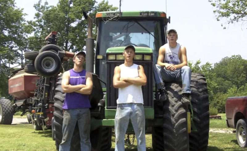 "This frame grab from video shows Assaria, Kan., brothers, from left: Nathan; Greg and Kendal Peterson in their video parody on LMAFO's ""Sexy and I Know It."" The parody, that has gone viral on YouTube and Facebook, shows the three brothers rapping their farming mission on the family's Saline County farm. (AP Photo/Courtesy Greg Peterson)"