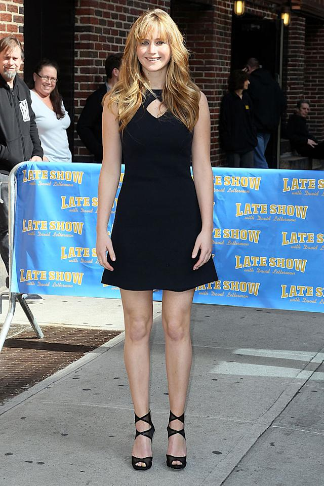 """<a target=""""_blank"""" href=""""http://movies.yahoo.com/movie/the-hunger-games/"""">""""Hunger Games""""</a> hottie Jennifer Lawrence wowed the New York City crowd upon arriving at the Ed Sullivan Theater for a Tuesday night appearance on """"Late Show with David Letterman."""" The 21-year-old actress -- whose soon-to-be blockbuster opens Friday -- looked absolutely adorable in a simple yet chic Raoul LBD and strappy Jimmy Choo peep-toes. And that blown-out mane... marvelous! (3/20/2012)"""