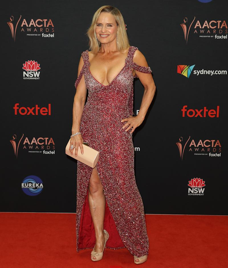 Shaynna Blaze pictured in low-cut dress on AACTAs red carpet