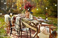 <p>Bring the inviting feel of your indoor dining table straight to the outdoors. To complete your table, flank a tall arrangement of foliage with lanterns. Add pillows and throw blankets on seating to create a cozy atmosphere.</p>