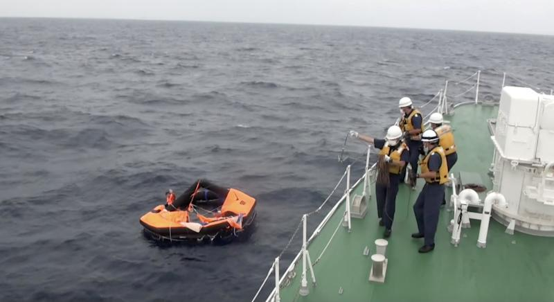 A Filipino crew member of Gulf Livestock 1, a cargo ship carrying livestock and dozens of crew that went missing after issuing a distress signal due to Typhoon Maysak, floating on a life raft, is rescued by Japan Coast Guard crew onboard the vessel Kaimon at the East China Sea, to the west of Amami Oshima island in southwestern Japan.