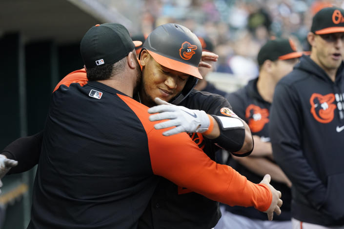 Baltimore Orioles' Pedro Severino is greeted in the dugout after his solo home run during the fifth inning of a baseball game against the Detroit Tigers, Friday, July 30, 2021, in Detroit. (AP Photo/Carlos Osorio)