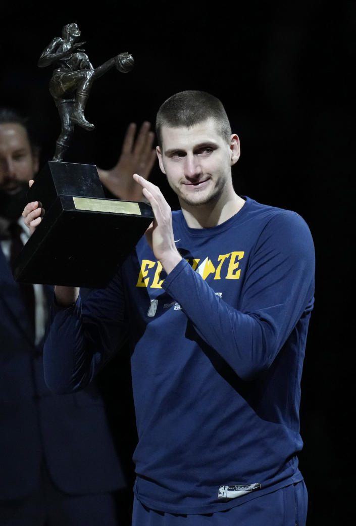 Denver Nuggets center Nikola Jokic accepts the Most Valuable Player award before Game 3 of an NBA second-round playoff series against the Phoenix Suns, Friday, June 11, 2021, in Denver. (AP Photo/David Zalubowski)