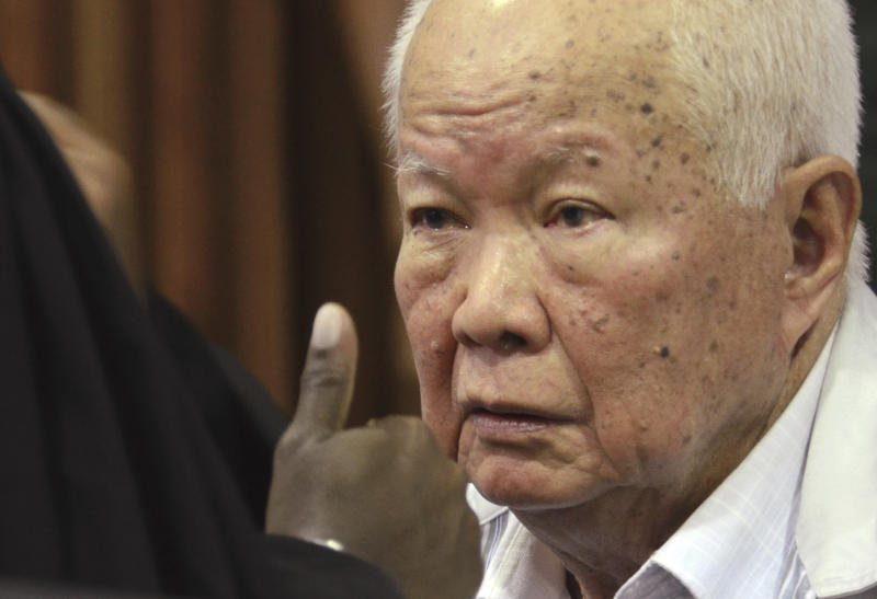 In this photo released by the Extraordinary Chambers in the Courts of Cambodia, Khieu Samphan, former Khmer Rouge head of state, sits in a court room before a hearing at the U.N.-backed war crimes tribunal in Phnom Penh, Cambodia, Friday, Nov. 16, 2018. The international tribunal to judge the criminal responsibility of former Khmer Rouge leaders for the deaths of an estimated 1.7 million Cambodians opened its session Friday to deliver its verdicts on charges of genocide and other crimes. (Nhet Sok Heng/Extraordinary Chambers in the Courts of Cambodia via AP)