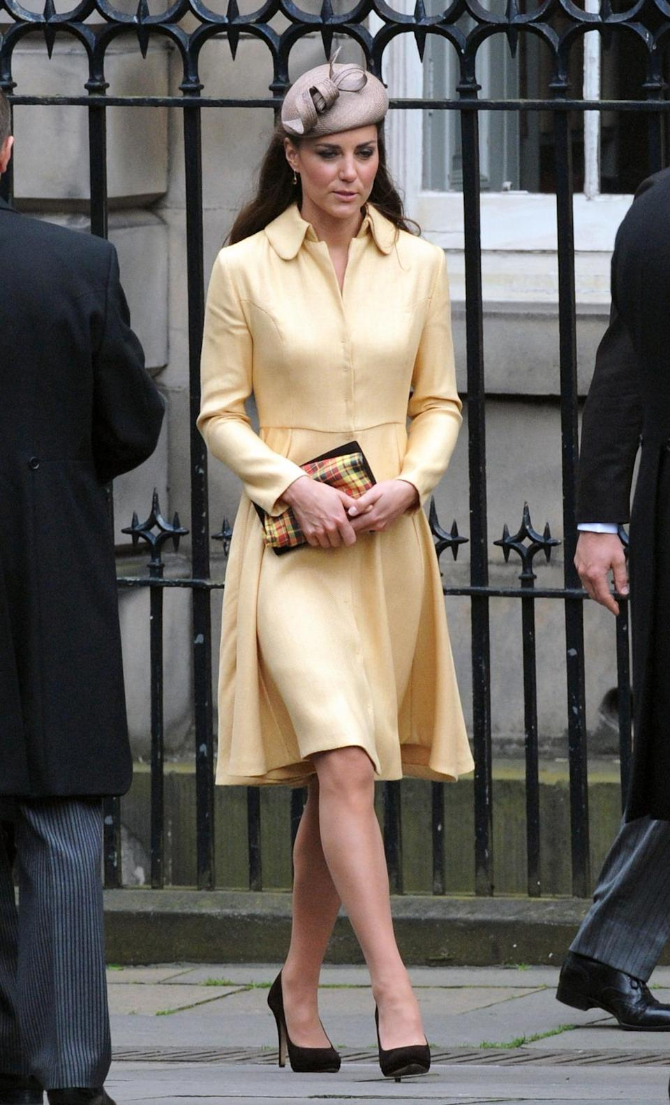 <p>For a ceremony in Scotland, the Duchess donned a bespoke yellow look by Emilia Wickstead. She paired the look with a cappuccino Whiteley hat and matching brown shoes and clutch from Emmy London.</p><p><i>[Photo: PA]</i></p>