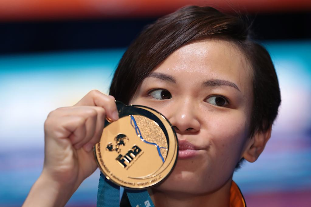 Malaysia's Jun Hoong Cheong poses with her gold medal during the podium ceremony for the women's 10m platform final during the diving competition at the 2017 FINA World Championships in Budapest, on July 19, 2017. (AFP Photo/FERENC ISZA)