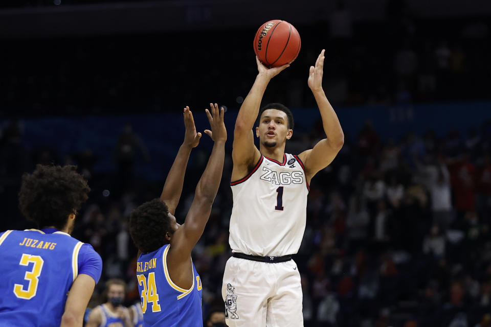 INDIANAPOLIS, INDIANA - APRIL 03: Jalen Suggs #1 of the Gonzaga Bulldogs shoots a game-winning three point basket in overtime to defeat the UCLA Bruins 93-90 during the 2021 NCAA Final Four semifinal at Lucas Oil Stadium on April 03, 2021 in Indianapolis, Indiana. (Photo by Jamie Squire/Getty Images)