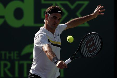 Mar 24, 2018; Key Biscayne, FL, USA; Roger Federer of Switzerland hits a backhand against Thanasi Kokkinakis of Australia (not pictured) on day five of the Miami Open at Tennis Center at Crandon Park. Kokkinakis won 3-6, 6-3, 7-6(4). Mandatory Credit: Geoff Burke-USA TODAY Sports