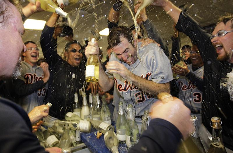 Detroit Tigers' Justin Verlander (35) is drenched with sparkling wine by teammates at the end of Game 5 during the American League division baseball series in Oakland, Calif., Thursday, Oct. 11, 2012. (AP Photo/Ben Margot)