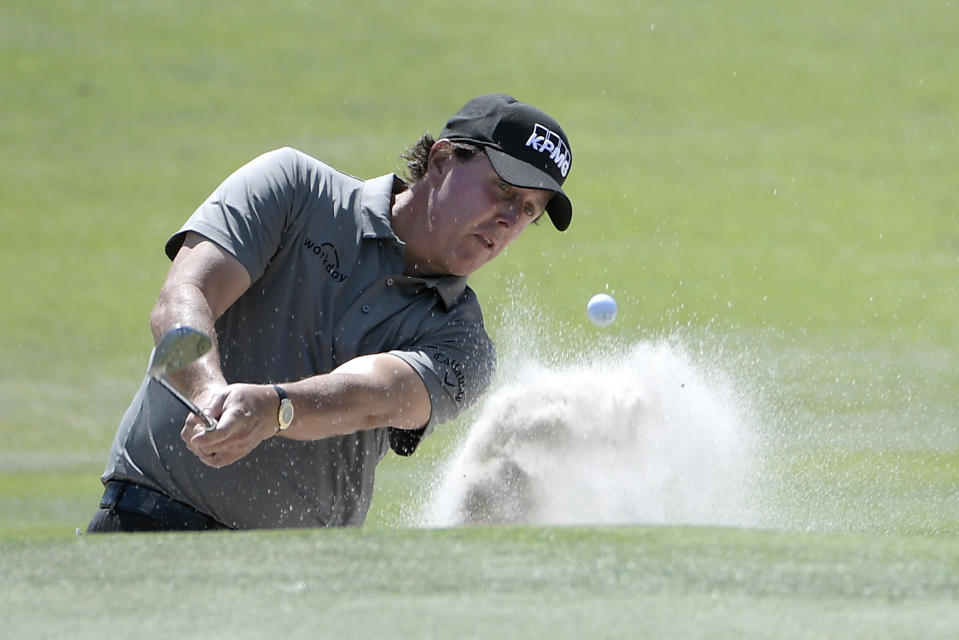 Phil Mickelson hits out of a bunker onto the second green during the first round of the Arnold Palmer Invitational golf tournament Thursday, March 7, 2019, in Orlando, Fla. (AP Photo/Phelan M. Ebenhack)