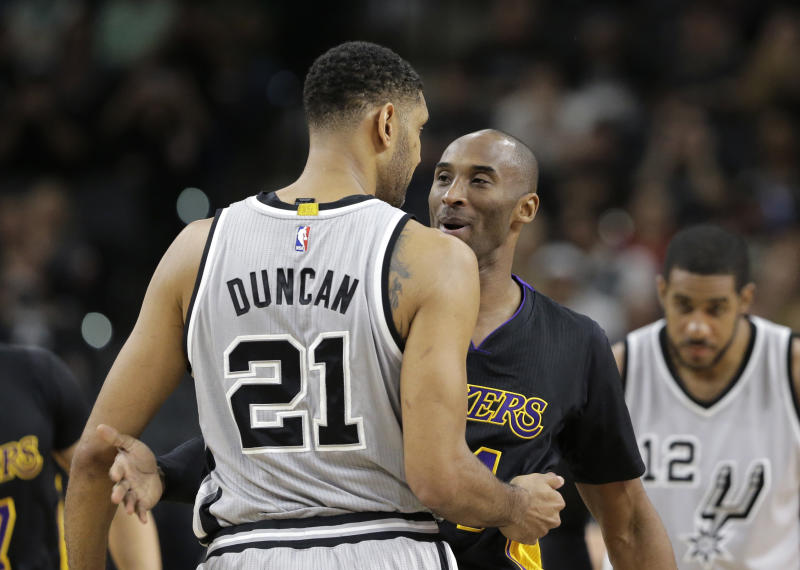 San Antonio Spurs center Tim Duncan (21) hugs Los Angeles Lakers forward Kobe Bryant (24) prior to an NBA basketball game, Friday, Dec. 11, 2015, in San Antonio. (AP Photo/Eric Gay)