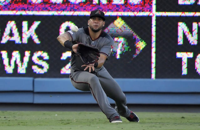 Arizona Diamondbacks left fielder David Peralta makes a catch on a ball hit by Los Angeles Dodgers' A.J. Pollock during the first inning of a baseball game Saturday, Aug. 10, 2019, in Los Angeles. (AP Photo/Mark J. Terrill)