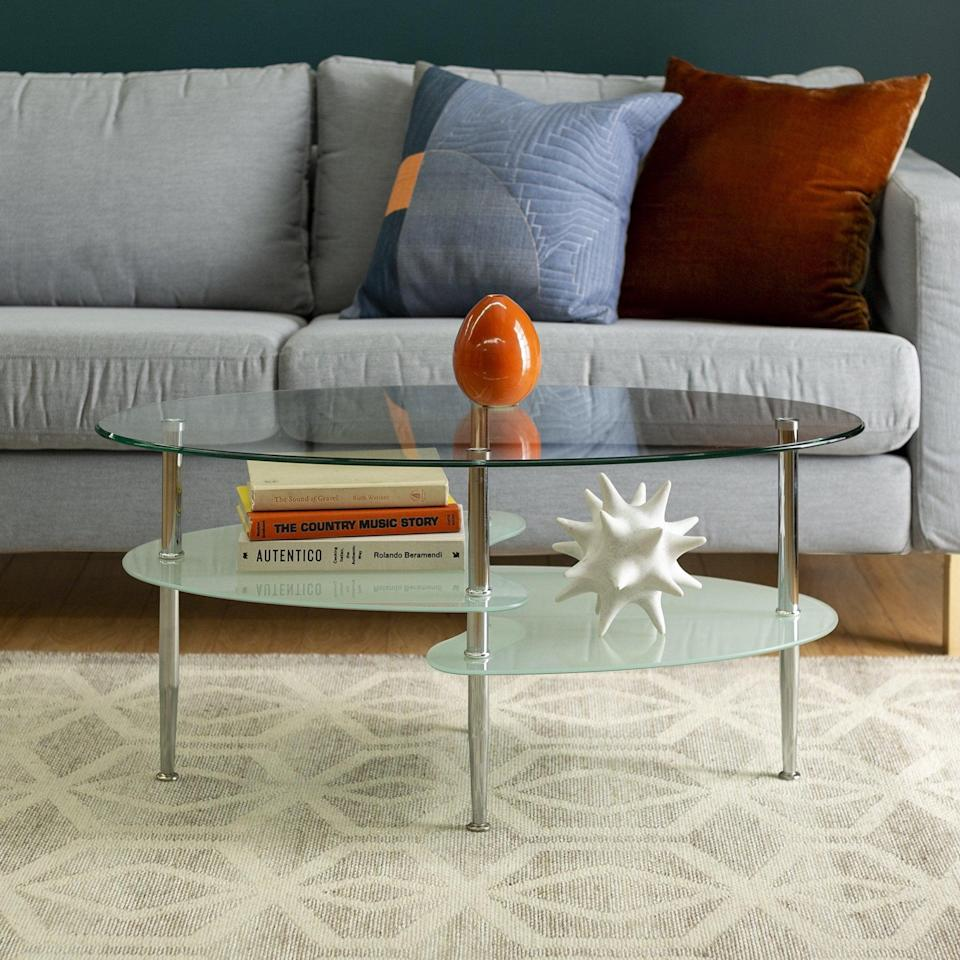 <p>Give your space a sleek flair with this <span>Walker Edison Mid-Century Modern Oval Glass Coffee Table</span> ($85, originally $220).</p>