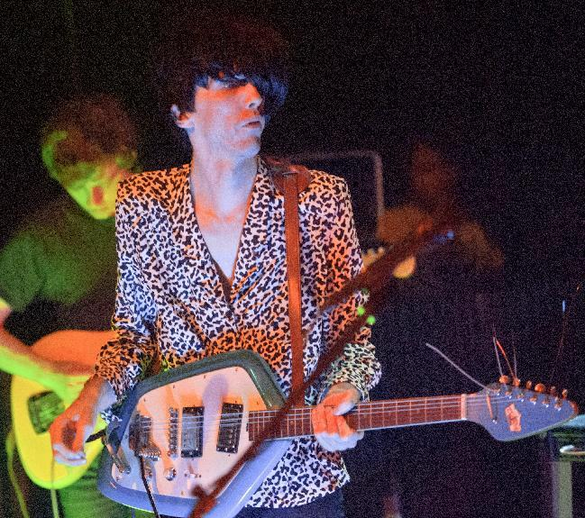 Bradford Cox plays his guitar along with other members of the indie rock group Deerhunter, perform at One Eyed Jack's in the French Quarter in New Orleans, Monday, April 29, 2013. (AP Photo/Matthew Hinton)