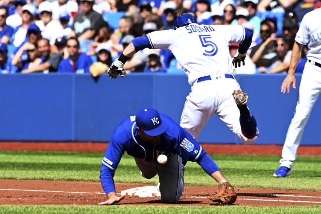 Toronto Blue Jays' Eric Sogard is safe at first base after Kansas City Royals Lucas Duda drops the ball during the first inning of a Major League baseball game against the Kansas City Royals, in Toronto, Saturday, June 29, 2019. (Jon Blacker/The Canadian Press via AP)