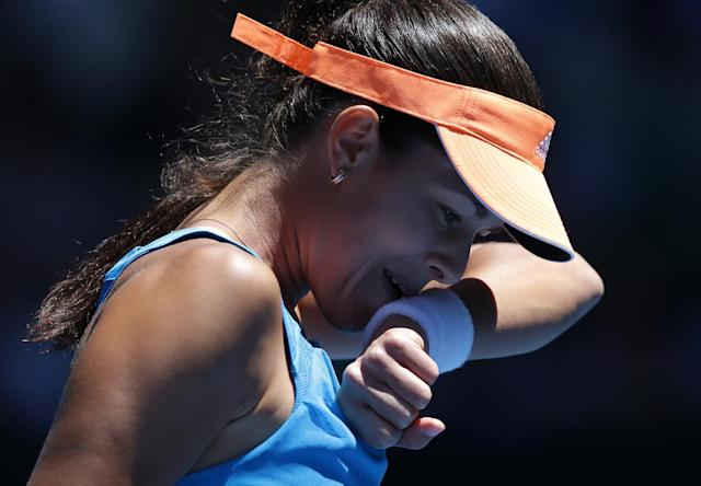 Ana Ivanovic of Serbia wipes the sweat from her face as she plays Eugenie Bouchard of Canada during their quarterfinal at the Australian Open tennis championship in Melbourne, Australia, Tuesday, Jan. 21, 2014.(AP Photo/Aaron Favila)