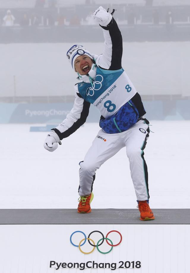 Cross-Country Skiing - Pyeongchang 2018 Winter Olympics - Men's 50km Mass Start Classic - Alpensia Cross-Country Skiing Centre - Pyeongchang, South Korea - February 24, 2018 - Gold medallist Iivo Niskanen of Finland celebrates on the podium during the victory ceremony. REUTERS/Kai Pfaffenbach