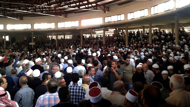Members of Syrian's Druze community hold a mass funeral for some of the 250 victims of an Islamic State group (IS) bombing and shooting rampage in Sweida province on July 25, 2018 (AFP Photo/STR)