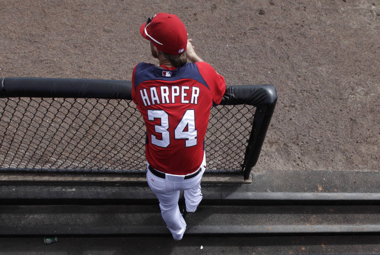 Washington Nationals prospect Bryce Harper hangs out in the dugout during spring training baseball, Thursday, March 1, 2012, in Viera, Fla. (AP Photo/Julio Cortez)