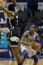 Charlotte Hornets' Devonte' Graham (4) draws a shooting foul on Brooklyn Nets' DeAndre Jordan during the second half of an NBA basketball game in Charlotte, N.C., Friday, Dec. 6, 2019. The Nets won 111-104. (AP Photo/Bob Leverone)