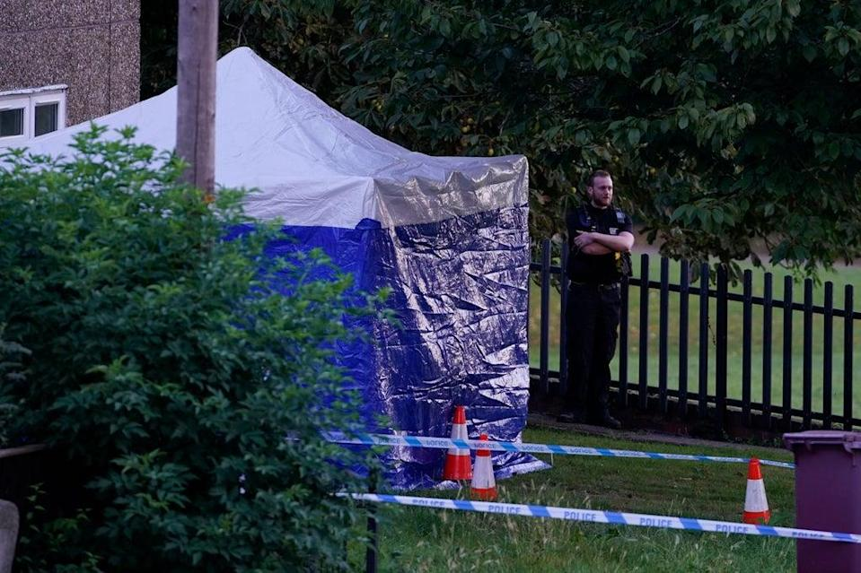 A police tent at the scene in Chandos Crescent in Killamarsh (PA)