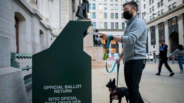 PHOTO: A voter casts his early voting ballot at drop box outside of City Hall on October 17, 2020, in Philadelphia. (Mark Makela/Getty Images, FILE)