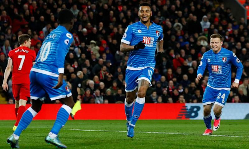 Joshua King, centre, celebrates scoring Bournemouth's late equaliser at Anfield to deny Liverpool victory.