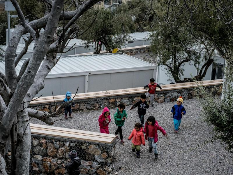 Children play among Iso-boxes, containers converted into refugee shelters, at Kara Tepe refugee camp in Lesvos, Greece (Unicef)