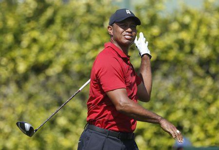 Mar 18, 2018; Orlando, FL, USA; Tiger Woods hits his tee shot on the ninth tee between two corporate tents right of the fairway on the ninth hole during the final round of the Arnold Palmer Invitational golf tournament at Bay Hill Club & Lodge . Mandatory Credit: Reinhold Matay-USA TODAY Sports
