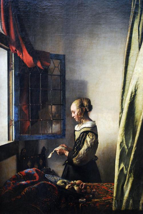 """""""Girl Reading a Letter at an Open Window"""" by Johannes Vermeer."""
