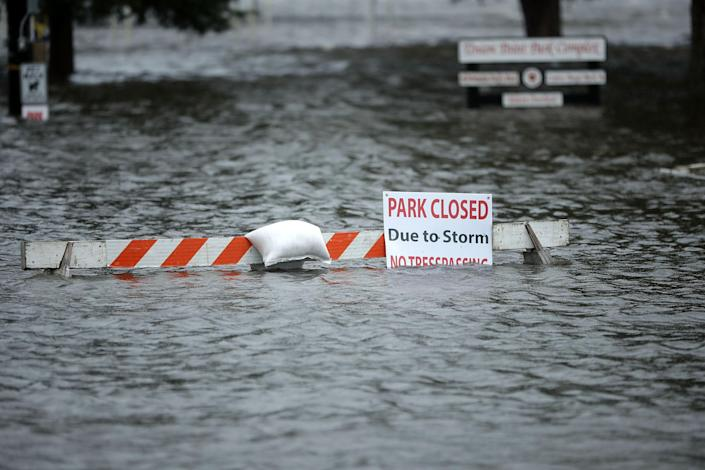 <p>A sign warns people away from Union Point Park after is was flooded by the Neuse River during Hurricane Florence September 13, 2018 in New Bern, N.C. (Photo: Chip Somodevilla/Getty Images) </p>