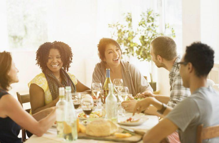 Group laughing at dinner table