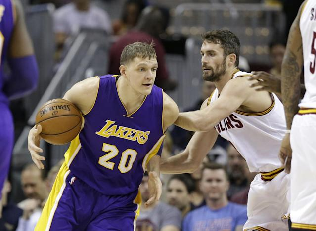 Timofey Mozgov's four-year, $64 million contract isn't quite working out for the Lakers. (AP)