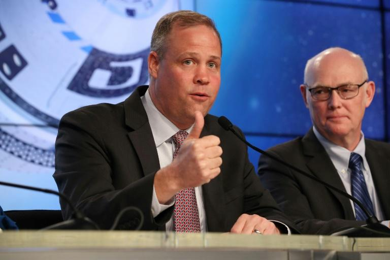 NASA Administrator Jim Bridenstine (L) says Boeing's Starliner capsule accomplished at least some of its objectives (AFP Photo/JOE RAEDLE)