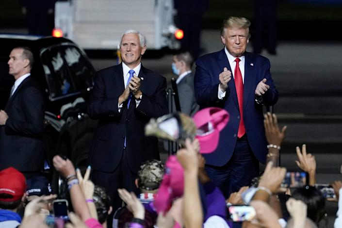 SEPTEMBER 25: U.S. President Donald Trump and Vice President Mike Pence arrive for a campaign rally at Newport News/Williamsburg International Airport on September 25, 2020.