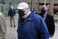 Michael Skakel arrives to a courthouse in Stamford, Conn., Friday, Oct. 30, 2020. Skakel, a Kennedy cousin, is expected at a court hearing as Connecticut prosecutors decide whether to retry him for the bludgeoning death of a fellow teenager in 1975. (AP Photo/Seth Wenig)