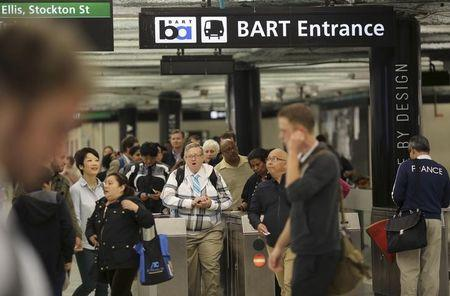 Passengers depart from the Powell Street Bay Area Rapid Transit (BART) and MUNI public transportation system station in San Francisco, California July 23, 2014. REUTERS/Robert Galbraith