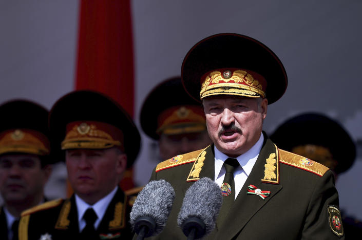FILE In this file photo taken on Saturday, May 9, 2020, Lukashenko refused to impose any restrictions, making Belarus the only country in Europe to continue playing professional soccer games with fans in the stands while the outbreak was in full swing. Religious service and other mass gatherings went on unimpeded, and the nation had a massive military parade in May to mark the 75th anniversary of the Nazi defeat in World War II. (Sergei Gapon/Pool via AP, File)